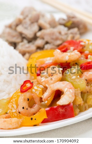rice, chicken and vegetables with shrimp, close-up, vertical