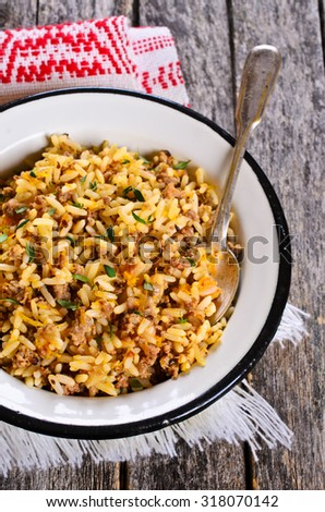 Rice cooked with minced meat and vegetables. Selective focus.