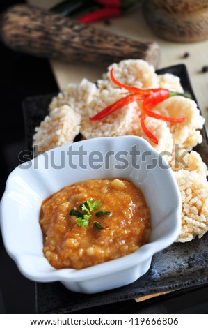 Rice cracker with spicy dip sauce in Thai style - stock photo