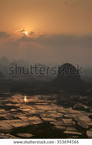 rice fields with water,yangshuo guangxi province china - stock photo