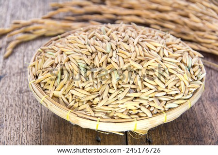 Rice grain in basket - stock photo
