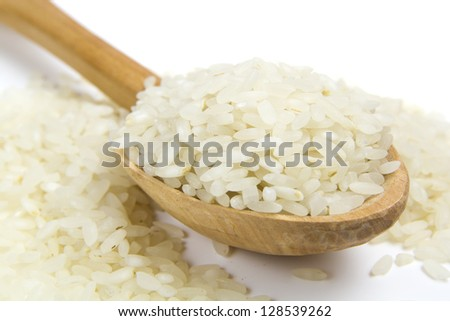 Rice grain in wooden old spoon isolated on white background - stock photo