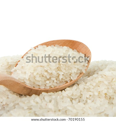 rice grain in wooden spoon isolated on white background - stock photo