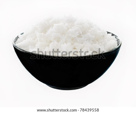 Rice in a bowl on a white background - stock photo