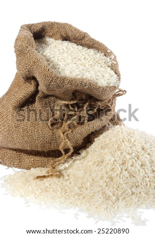 Rice in a sack and spilled on a white background - stock photo