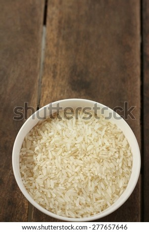 rice in a white bowl on a table - stock photo