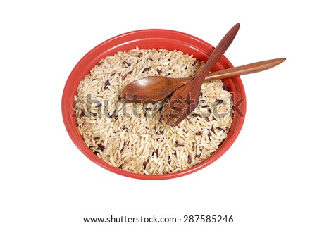 Rice in red bowl and spoon isolated on white background - stock photo