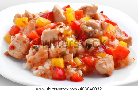 Rice in sauce with chicken and vegetables