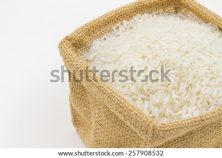 rice in small burlap sack - stock photo