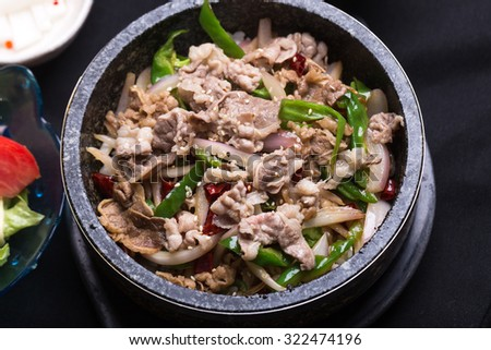 rice mix with assorted vegetables and beef meat in hot stone pot - stock photo