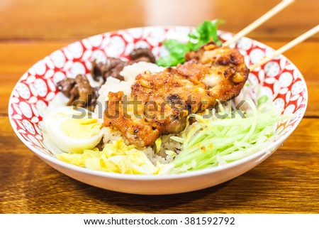 Rice Mixed with Shrimp paste and chicken grill In restaurant