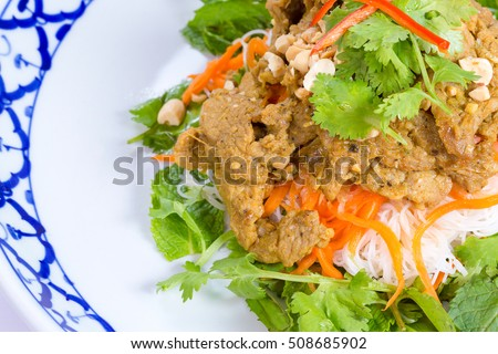 Rice noodles with pork and vegetable on white background