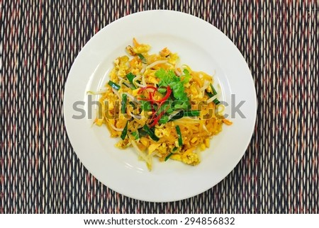Rice noodles with shrimp close-up on a plate. horizontal view from above  - stock photo