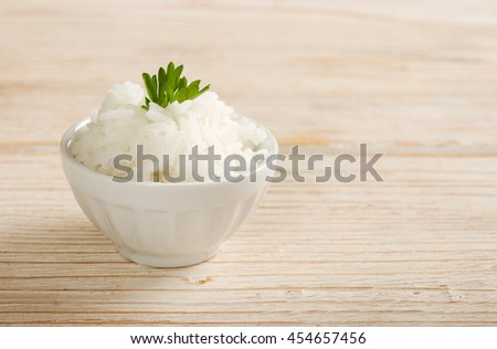 rice on a wooden background - stock photo