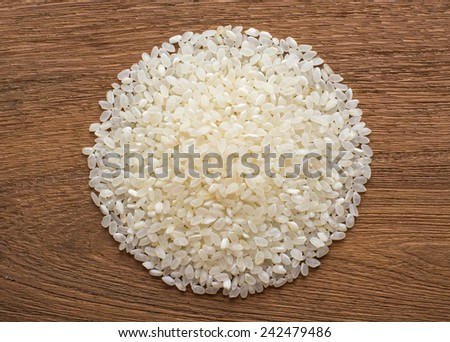 rice on wooden  background - stock photo