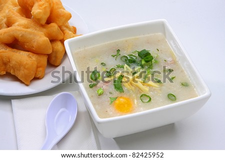Rice Porridge with Ground Pork served with Chinese Donut - stock photo