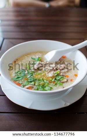 Rice porridge with pork and vegetable soup - stock photo