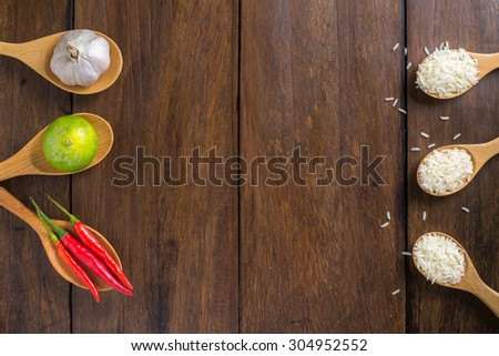 rice, Red chilli, garlic and lemon on wood texture background