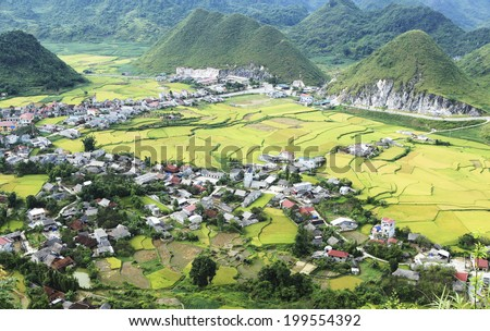 Rice terraces and village in Vietnam - stock photo