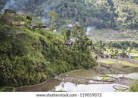rice terraces built into steep mountain sides in poor mountain town of banaue luzon in the philippines - stock photo