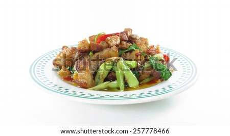 Rice topped with stir-fried crispy pork and basin                 - stock photo
