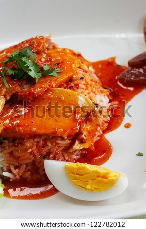 rice with chicken in red sauce - stock photo