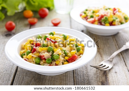 Rice with corn and green peas - stock photo