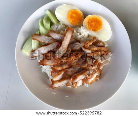 Rice with fry pork and boil eggs