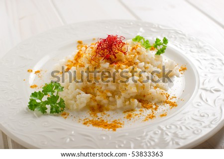 rice with natural saffron  and curry - stock photo