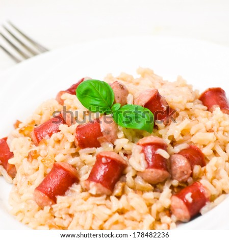 rice with sausage - stock photo