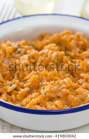 rice with seafood in dish with glass of wine