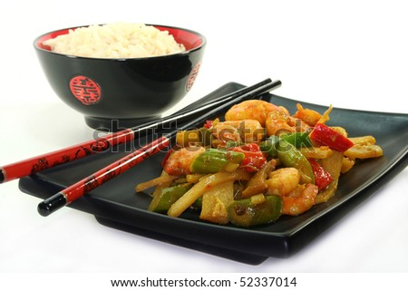 Rice with shrimp and Asian vegetable stir-fry on Asian dishes