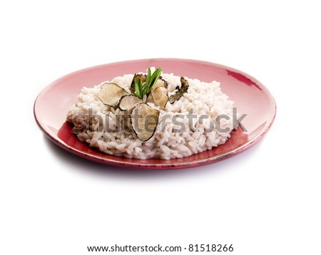 rice with truffle over red dish