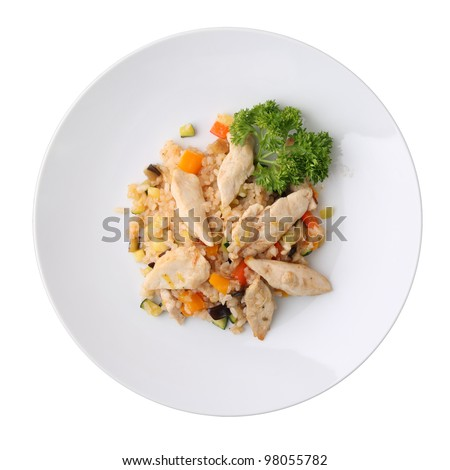 Rice with vegetables and pieces of chicken on white round dish isolated on a white background. Top view. - stock photo