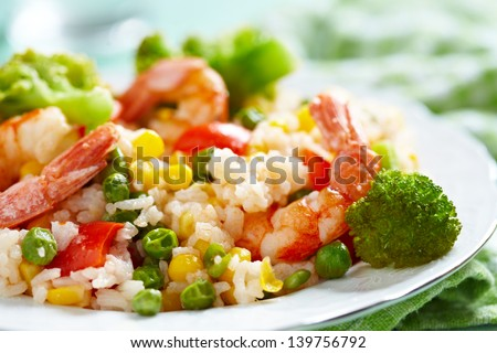 Rice with vegetables and shrimps - stock photo