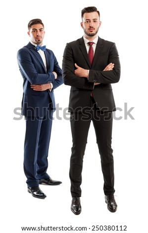 Rich and elegant business men wearing expensive suits with necktie and bow tie - stock photo