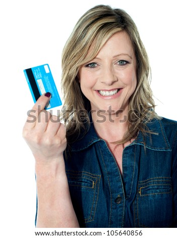 Rich attractive lady showing credit card and smiling at camera - stock photo