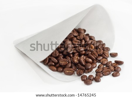 Rich Brown Whole Beans In Paper Coffee Filter