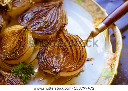 Rich browned golden caramelized balsamic onions roasted in the oven.