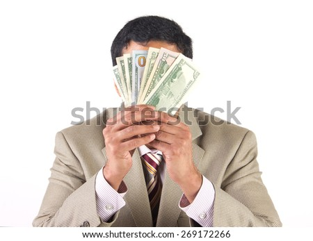 Rich businessman hiding behind american dollars - stock photo