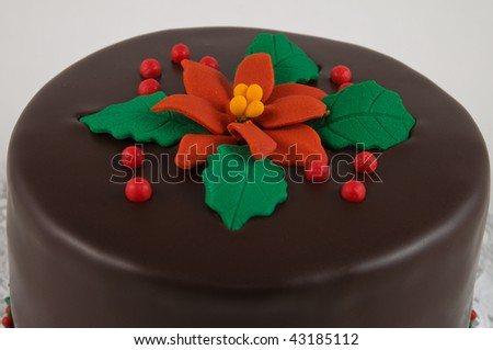 Rich dark chocolate cake decorated for Christmas - stock photo