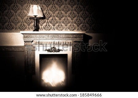 Rich interior with antique lamp and fireplace in red vintage room studio shooting - stock photo
