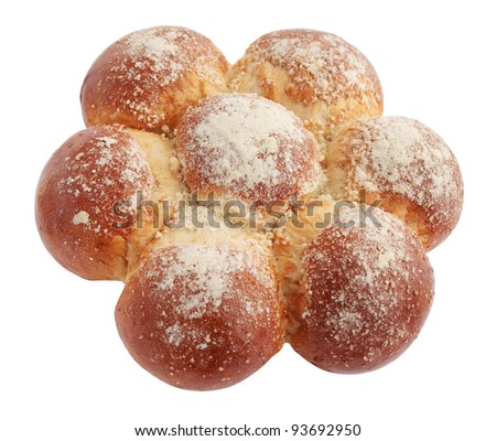 Rich loaf is strewn by powdered sugar - stock photo