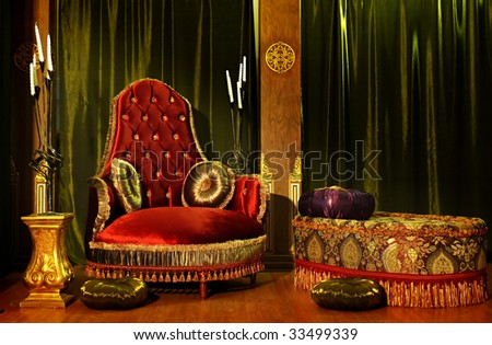Rich-looking armchair and table - stock photo