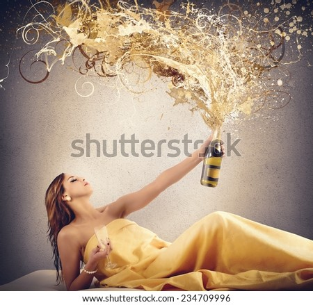 Rich luxury women blows up the champagne - stock photo