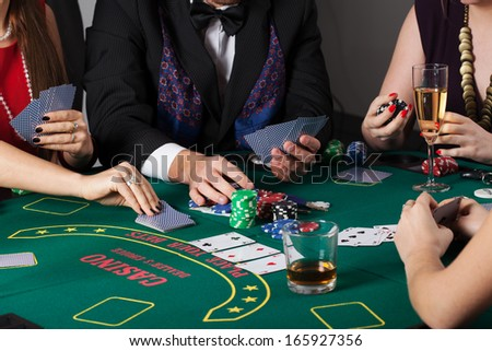 Rich people gambling in casino, poker game - stock photo