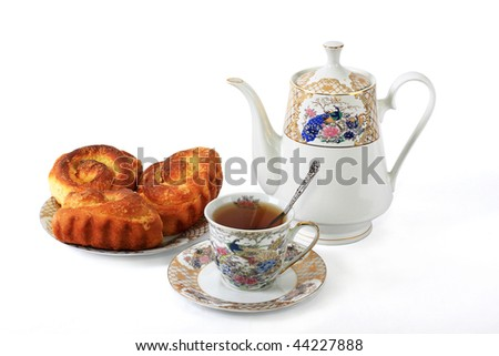 Rich rolls good addition to tea for a breakfast - stock photo