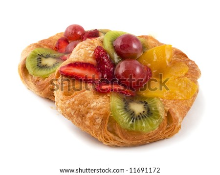 Rich rolls with fruit isolated on a white background - stock photo