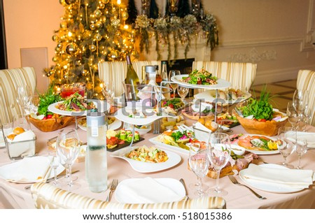 Rich served dinner table prepared for Christmas