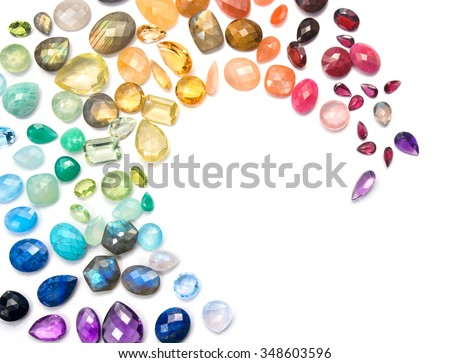 Rich variety of real colorful gemstones on the white background. - stock photo